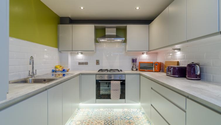 Sleek kitchen at the Citygate Apartment - Citybase Apartments