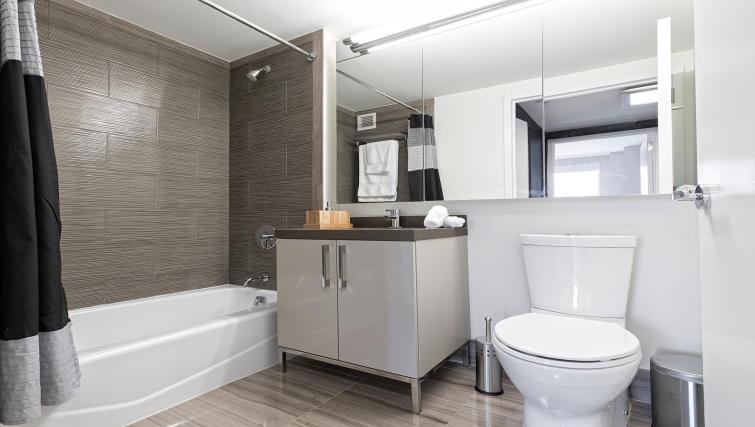 Bathroom at MiMa, Hell's Kitchen Apartment - Citybase Apartments