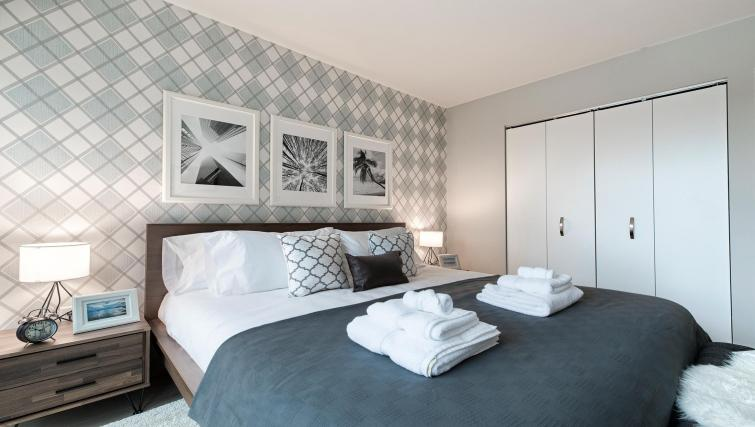 Bed at MiMa, Hell's Kitchen Apartment - Citybase Apartments