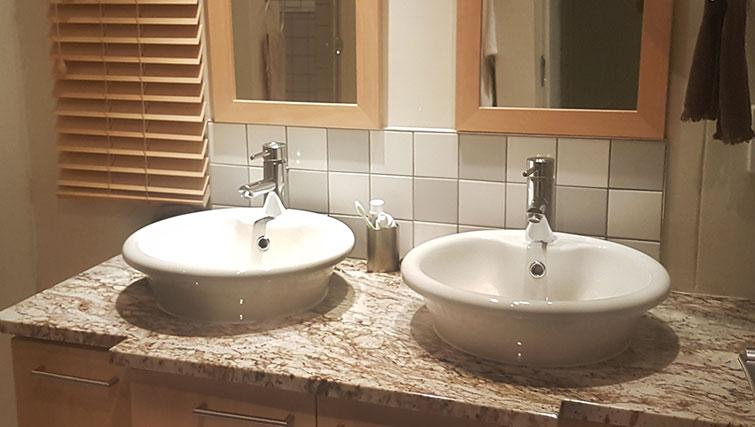 Bathroom at Weom Apartments - Citybase Apartments