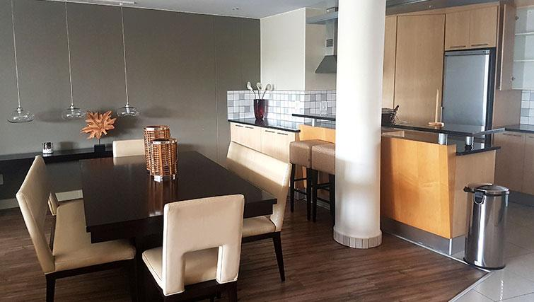 Dining area at Weom Apartments - Citybase Apartments