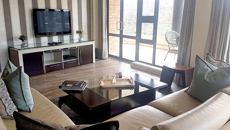 Living area at Weom Apartments - Citybase Apartments