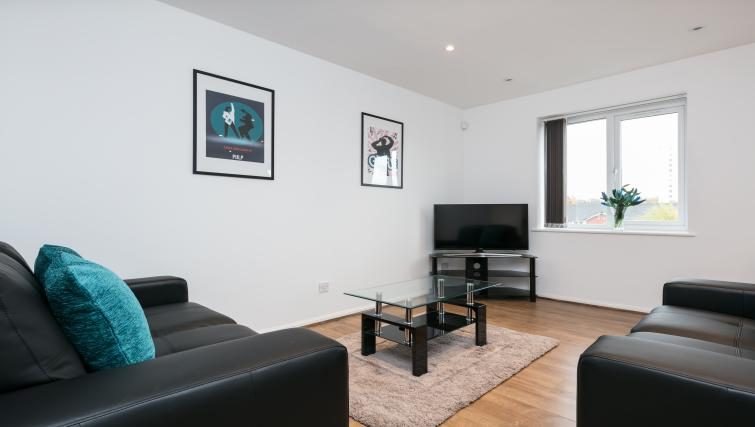 TV area atThe Riverside Apartment - Citybase Apartments