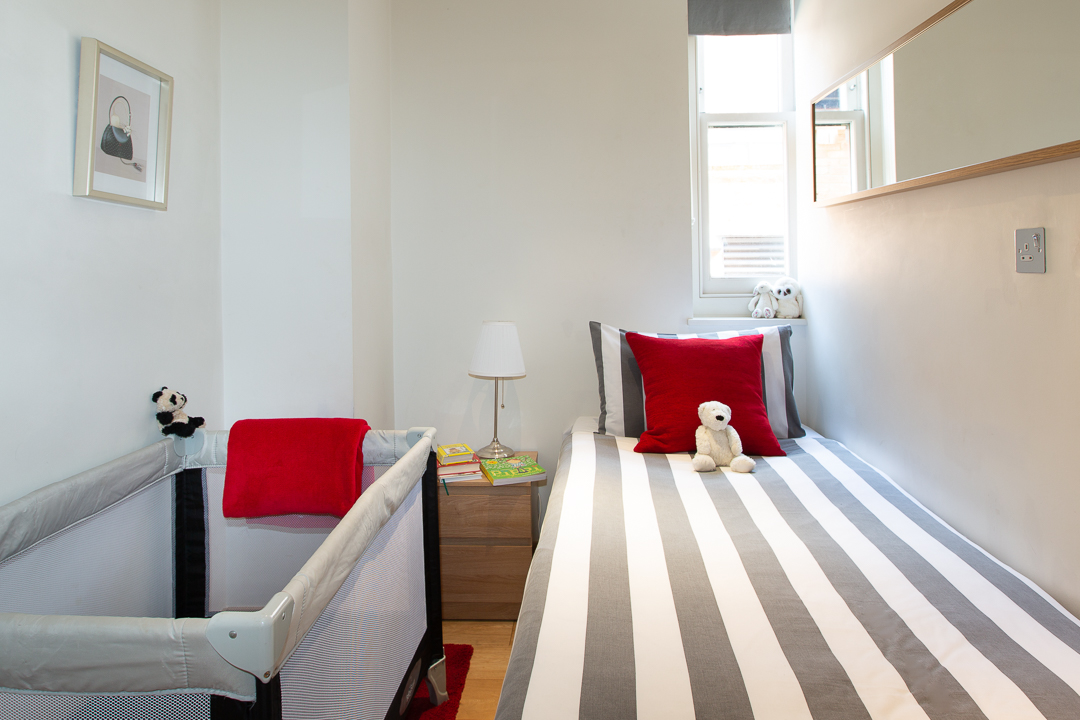 Single bed and cot at  St Peters Mews Apartments - Citybase Apartments