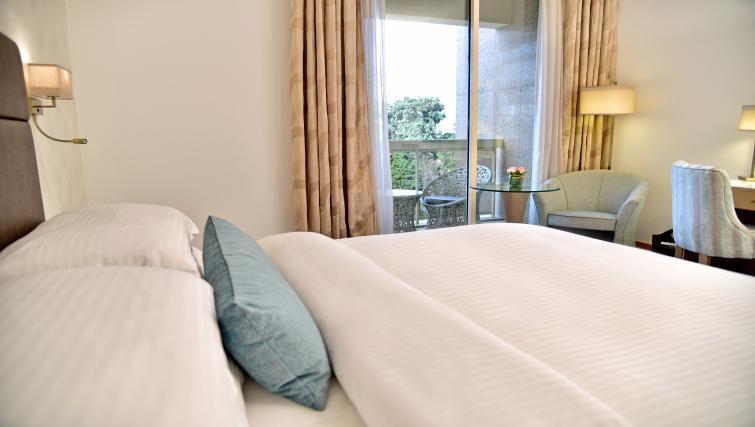 Bright bedroom at Gefinor Rotana - Citybase Apartments