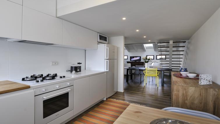 Modern kitchen at Curtatone Penthouse - Citybase Apartments