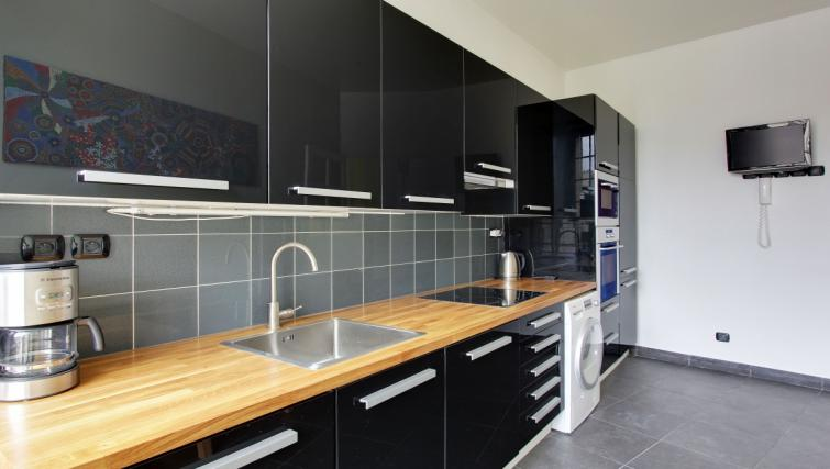 Fully equipped kitchen at Charming Charlemagne Apartment - Citybase Apartments