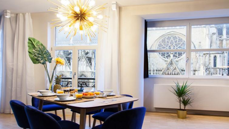 Dining area at the Regence III Apartment - Citybase Apartments