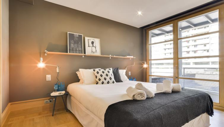 Bed at Couronne Apartments - Citybase Apartments