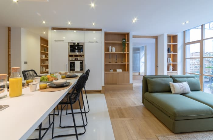Open-plan living area at Couronne Apartments - Citybase Apartments