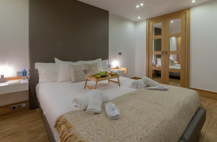 Spacious bedroom at Couronne Apartments - Citybase Apartments