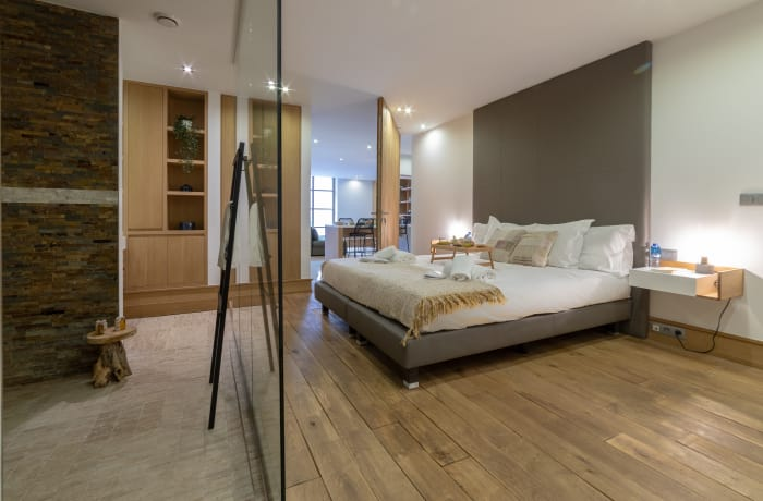 Modern bedroom area at Couronne Apartments - Citybase Apartments