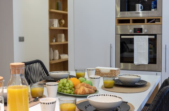Dining area at Couronne Apartmentse - Citybase Apartments