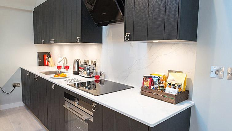 Fully equipped kitchen at Clarendon 44 Wellington Street Apartments - Citybase Apartments
