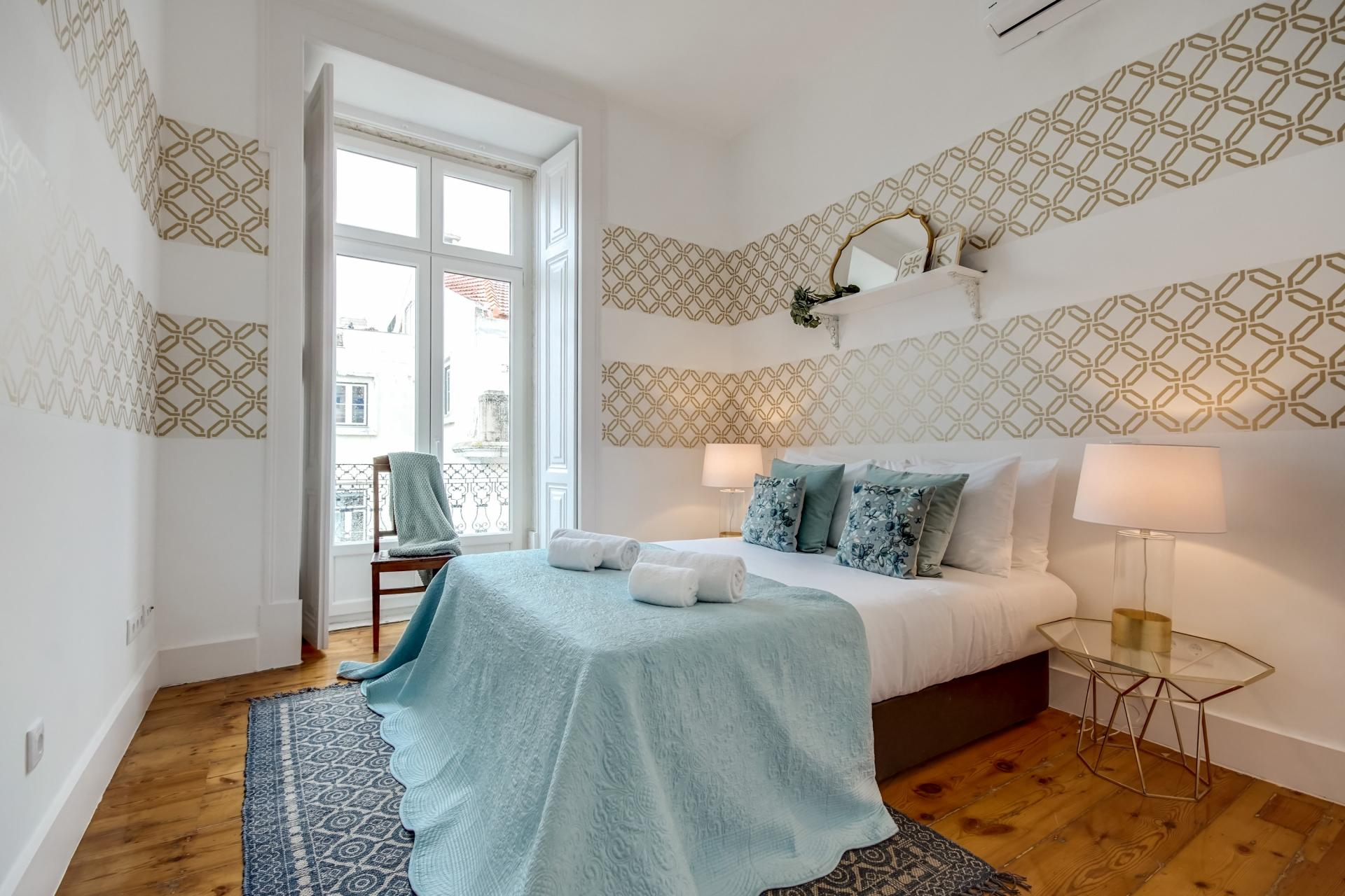 Cosy bedroom at Emenda Deluxe Apartment - Citybase Apartments