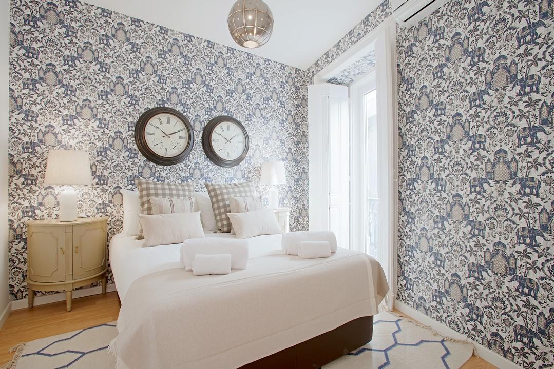 Stylish bedroom at Gloria Apartments - Citybase Apartments