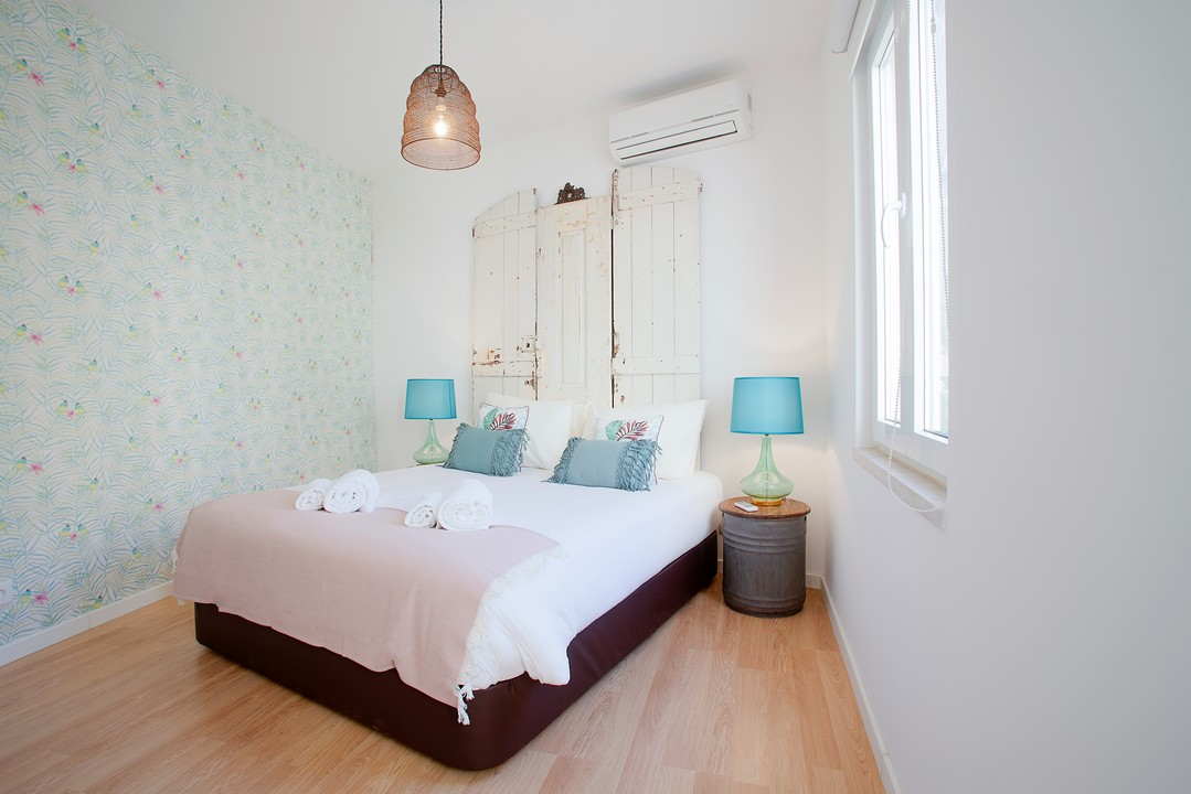 Double bed at Gloria Apartments - Citybase Apartments