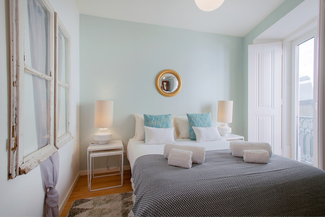 Bright bedroom at Gloria Apartments - Citybase Apartments