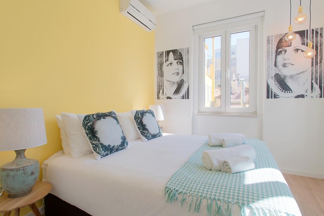 Charming bedroom at Gloria Apartments - Citybase Apartments