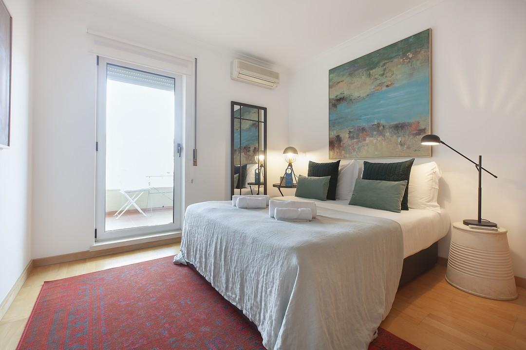 Cosy bedroom at Liberdade Executive Apartments - Citybase Apartments