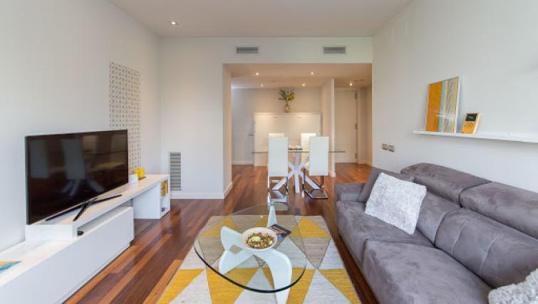 Sofa at Paseo de Gracia Apartments - Citybase Apartments