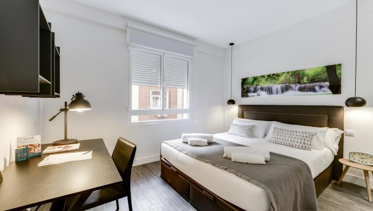 Bed at the San Bernardo Apartment - Citybase Apartments