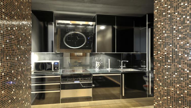 Kitchen at Foro Buonaparte Apartment - Citybase Apartments