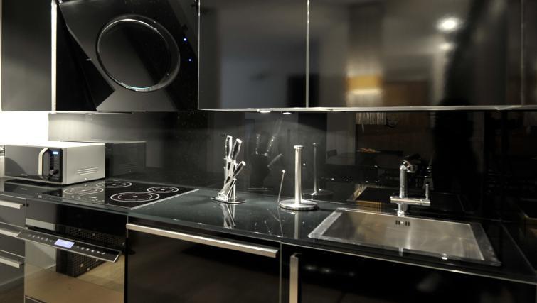 Kitchen facilities at Foro Buonaparte Apartment - Citybase Apartments