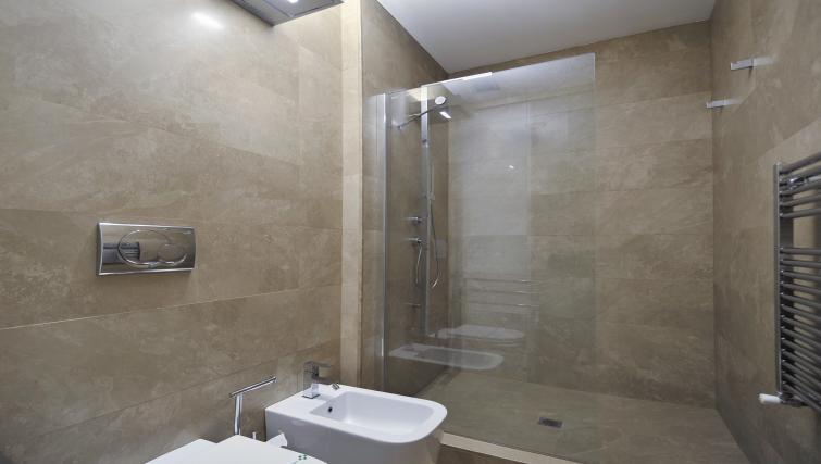 Bathroom at Foro Buonaparte Apartment - Citybase Apartments