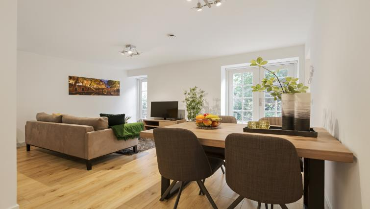Dining area at the Zwaansteeg Canal Garden Apartments - Citybase Apartments