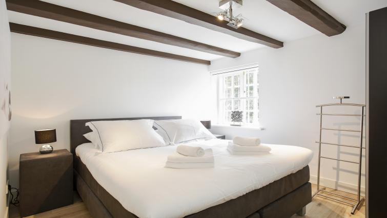 Luxurious bed at the Zwaansteeg Canal Garden Apartments - Citybase Apartments