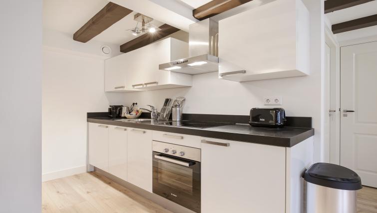 Kitchen area at the Zwaansteeg Canal Garden Apartments - Citybase Apartments