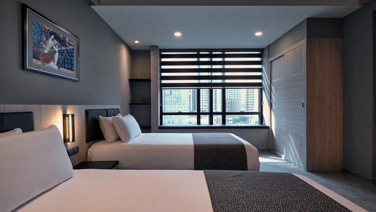 Cosy twin beds at the Orchard Grand Court Serviced Apartments, Singapore - Citybase Apartments