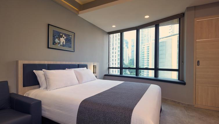 Bedroom at the Orchard Grand Court Serviced Apartments, Singapore - Citybase Apartments