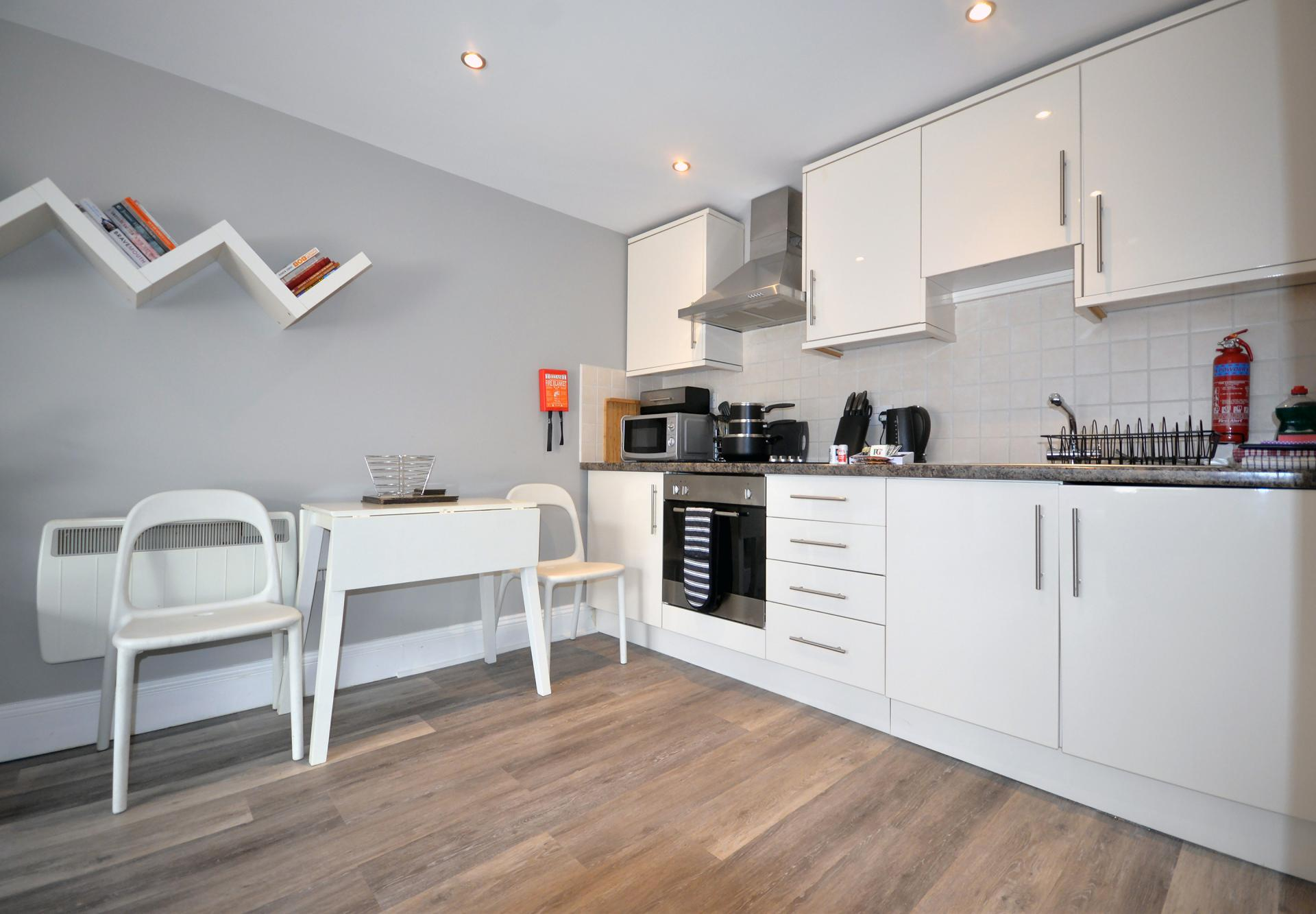 Fully equipped kitchen at Trinity Mews Apartment, Babbacombe, Torquay - Citybase Apartments