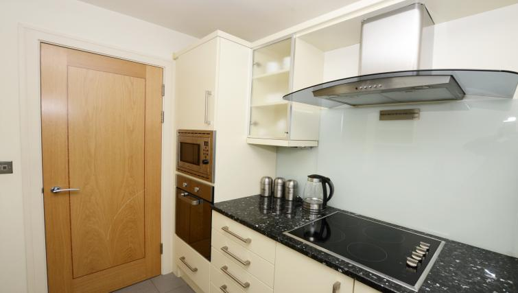 Kitchen in large studio at 1 Harrington Gardens - Citybase Apartments