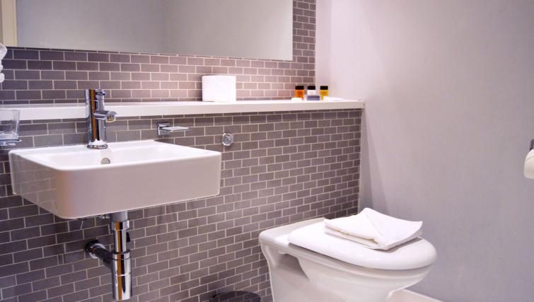 Bathroom in studio at 1 Harrington Gardens - Citybase Apartments