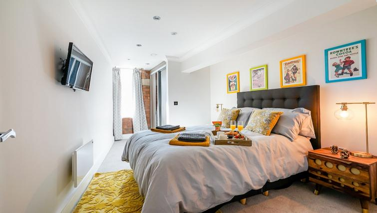 Bed at Cocoa Suites - Citybase Apartments