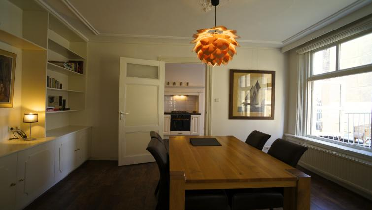 Dining area at Stayci Noordeinde Apartments - Citybase Apartments