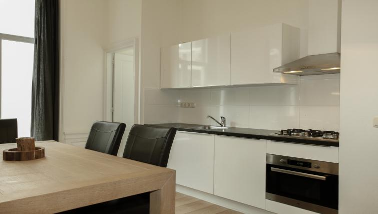 Kitchen at Stayci Grand Place Apartments - Citybase Apartments