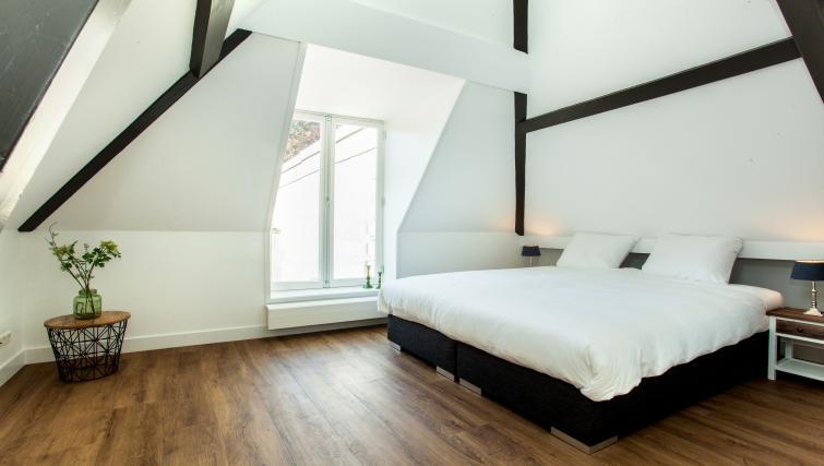 Bed at the Stayci Royal Palace Apartments - Citybase Apartments