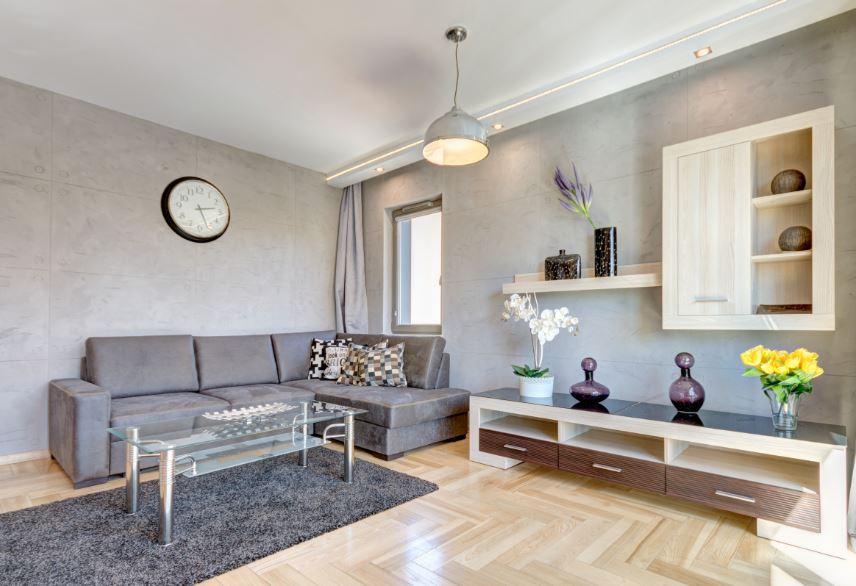 Grey sofa at Waterlane Residence Apartments, Srodmiescie, Gdansk - Citybase Apartments