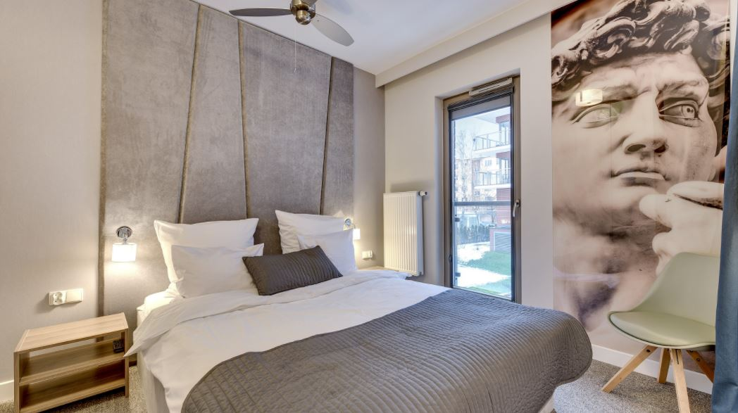 Bedroom at at Waterlane Residence Apartments, Srodmiescie, Gdansk - Citybase Apartments
