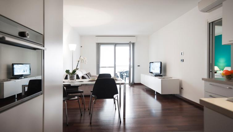 Dining area at Gramsci Apartment - Citybase Apartments
