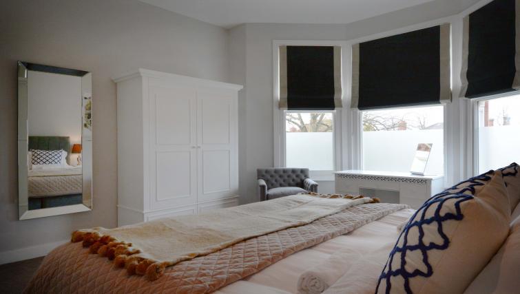 Bed at Dunara Suites - Citybase Apartments