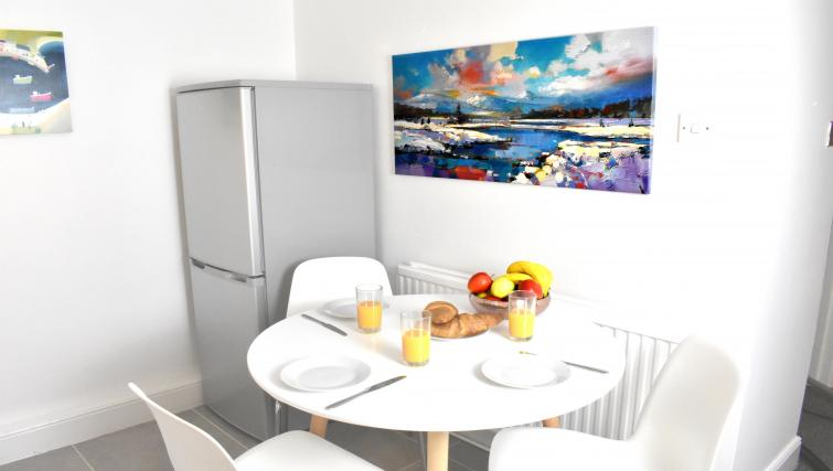 Dining table at Montpellier Villas Apartment - Citybase Apartments