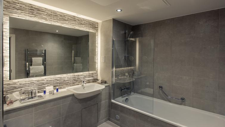 Bathroom at the Premier Suites Plus Bath Street Apartments - Citybase Apartments