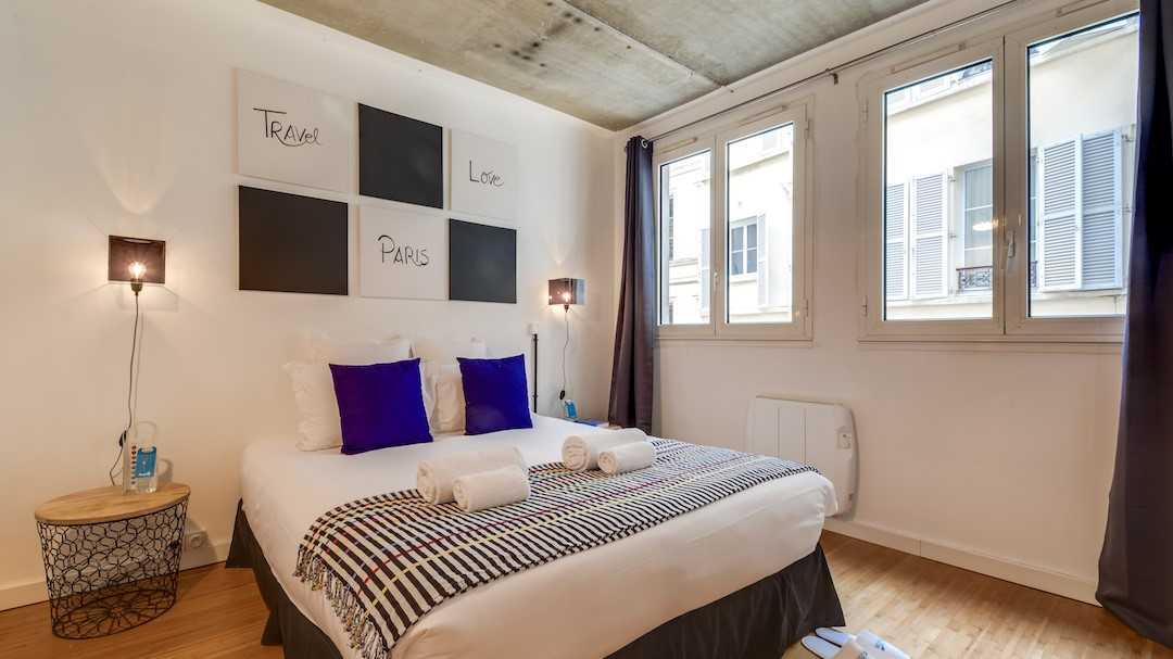 Cosy bedroom at  Rue de Milan Apartments - Citybase Apartments