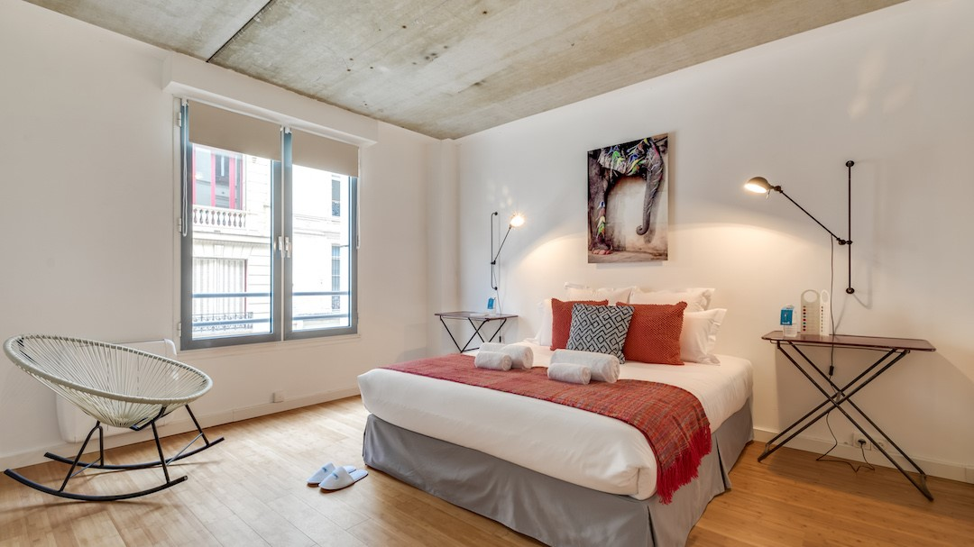 Bright bedroom at  Rue de Milan Apartments - Citybase Apartments