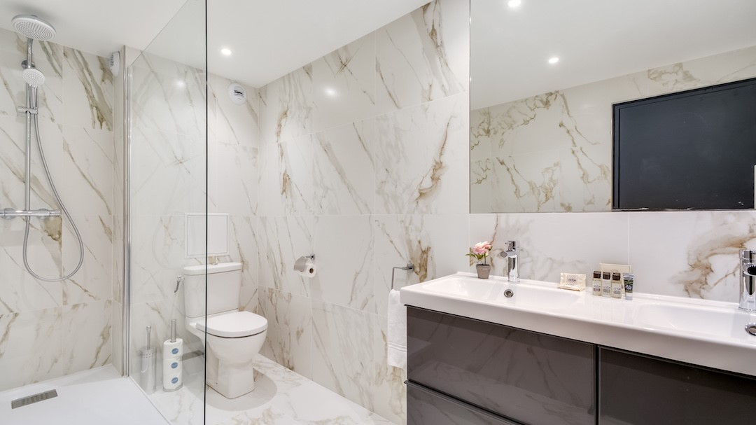 Sleek bathroom at  Rue de Milan Apartments - Citybase Apartments
